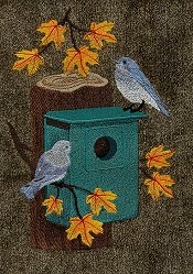 Bluebirds with birdhouse