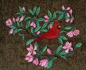 Cardinal in spring blossom tree